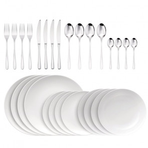 Cutlery and plates set for 4 at the table by Sambonet and Thomas