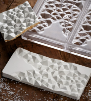 Fragment: polycarbonate mould for chocolate bar by Pavoni Professional